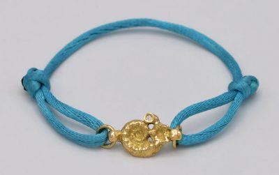 Bracelet cordon or fossile